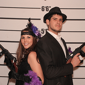 Chicago Murder Mystery party guests pose for mugshots